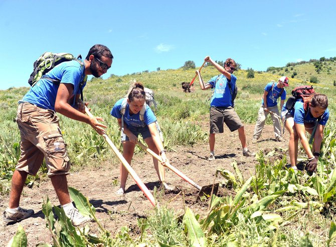 Volunteers work on the Rotary Trail near Steamboat Springs in July 2011. New trails on Emerald Mountain and Howelsen Hill could be the first to be funded by the city's lodging tax.