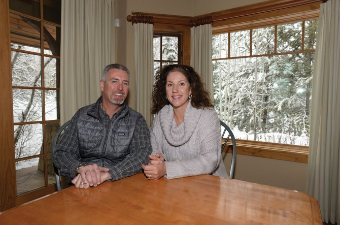 "Jim and Leagh Boyne sit in the dining area of their home in Steamboat Springs. The Boynes' move from Chicago to Steamboat Springs will be featured on one of HGTV's reality television shows, ""New House, New Life."""