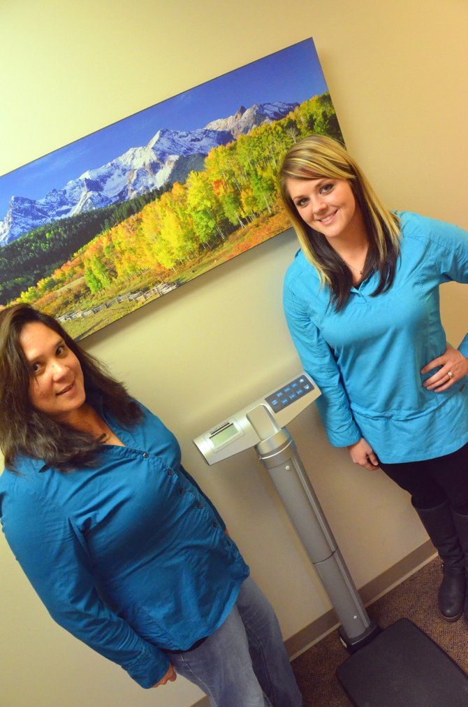 Community health educators Karla Larsen, left, and Jennifer Brockman await patients needing their weight checked with a scale in the hallway of Craig's Northwest Colorado Visiting Nurse Association. The VNA will offer a program called Lifestyle Change Challenge starting Wednesday that will allow participants to lose weight, reduce their risk of chronic diseases such as diabetes and learn more about maintaining a healthy weight.