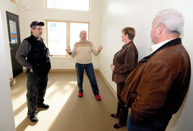 South Routt Medical Center board members Steve Strickler, center, and Chuck Wisecup, left, give a tour of the renovated building in Oak Creek to Colorado Department of Local Affairs officials. Staff will be moving into the new building April 11.