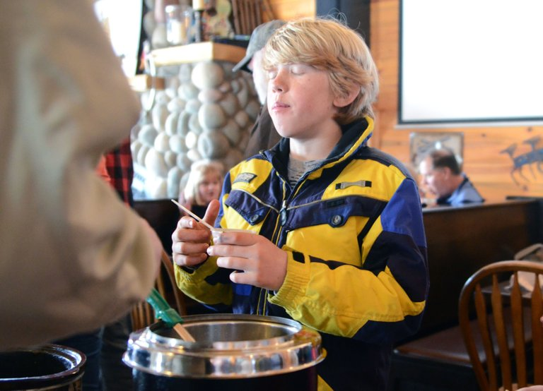 Soda Creek Elementary School student Daniel Kempers savors a bite of Di's Dynamite, the winner of the green chili category at the 12th annual North Routt Chili Cookoff on Sunday.