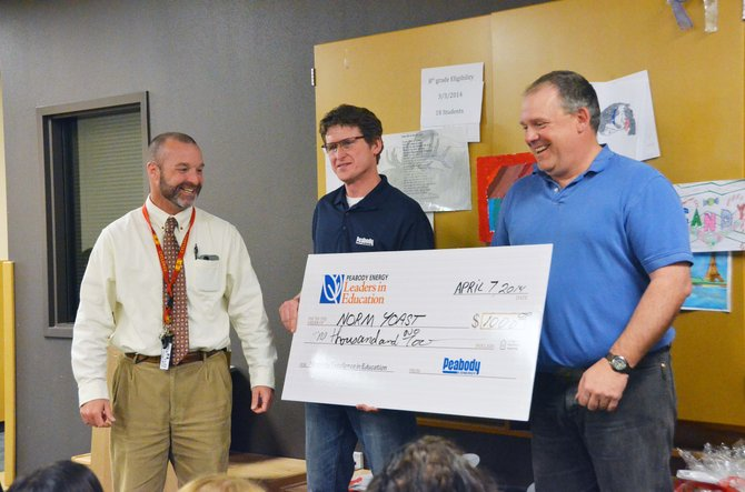 From left, Craig Middle School Principal Joe Libby and Scott Harrell, director of human resources for Colorado Peabody, present the Peabody Energy Leaders in Education Award and $1,000 to CMS science teacher Norm Yoast.