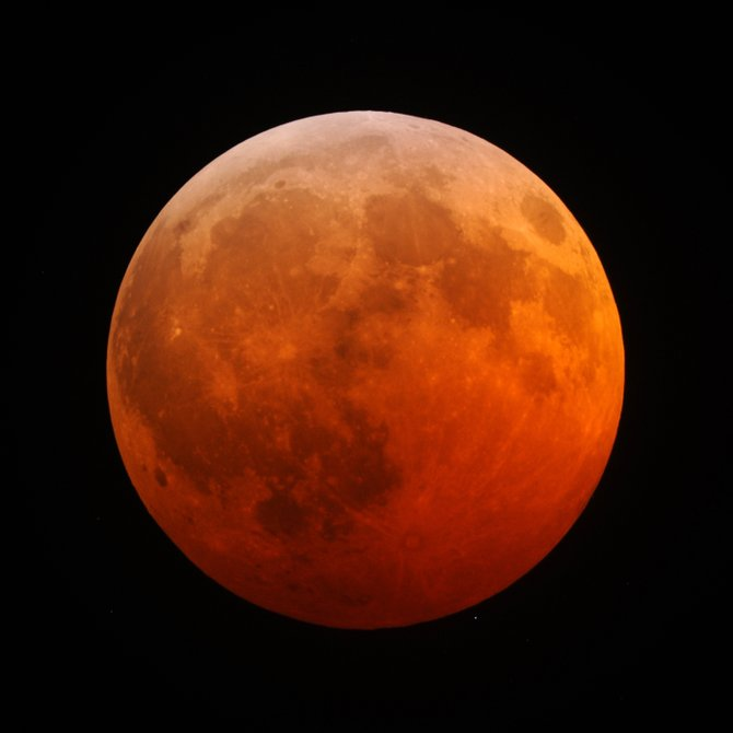 When eclipsed by the Earth's dark shadow, the moon glows with the combined light of every sunrise and sunset on Earth at that moment, projected onto the moon. This photo captured the total lunar eclipse of Dec. 21, 2010, the last one seen from Colorado. Next Monday night, the first of four consecutive total lunar eclipses will occur over Colorado.