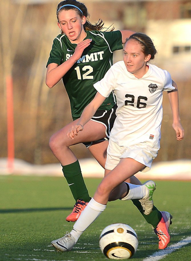 Steamboat's Meghan Garrecht-Connelly tries to break away from Summit's Claire Pennell on Tuesday as the Sailors picked up a 6-0 win against the Tigers.