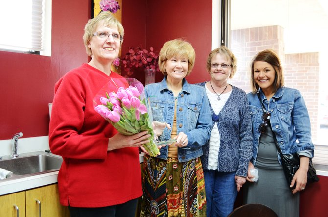 Moffat County United Way presented its Volunteer of the Year award to Robin Schiffbauer on Thursday. From left, Schiffbauer, Corrie Ponikvar, Gail Severson and Chelsey Hammer.