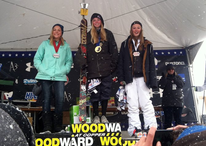 Paula Cooper stands atop the podium at the USASA Freeskiing National Championships at Copper Mountain with a little borrowed hardware. Maddy Bowman, who won gold in freeskiing half-pipe at the 2014 Winter Olympics in Sochi, Russia, was on hand and allowed her medal to be borrowed for the podium shot.