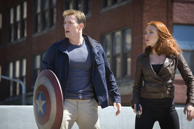 "Dressed in civilian clothes, Steve Rogers and Natasha Romanoff (Chris Evans, Scarlett Johansson), aka Captain America and Black Widow, seek to protect people from impending mayhem in ""Captain America: The Winter Soldier."" The movie is a sequel in which the titular World War II superhero and member of the Avengers still is adjusting to the modern world."