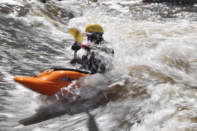 Erik Besselman battles the swift current of the Yampa River last week in his kayak near downtown Steamboat Springs. The river still was flowing at 1,030 cubic feet per second Monday afternoon, more than twice the median flow for the date of 461 cfs, according to the U.S. Geological Survey.