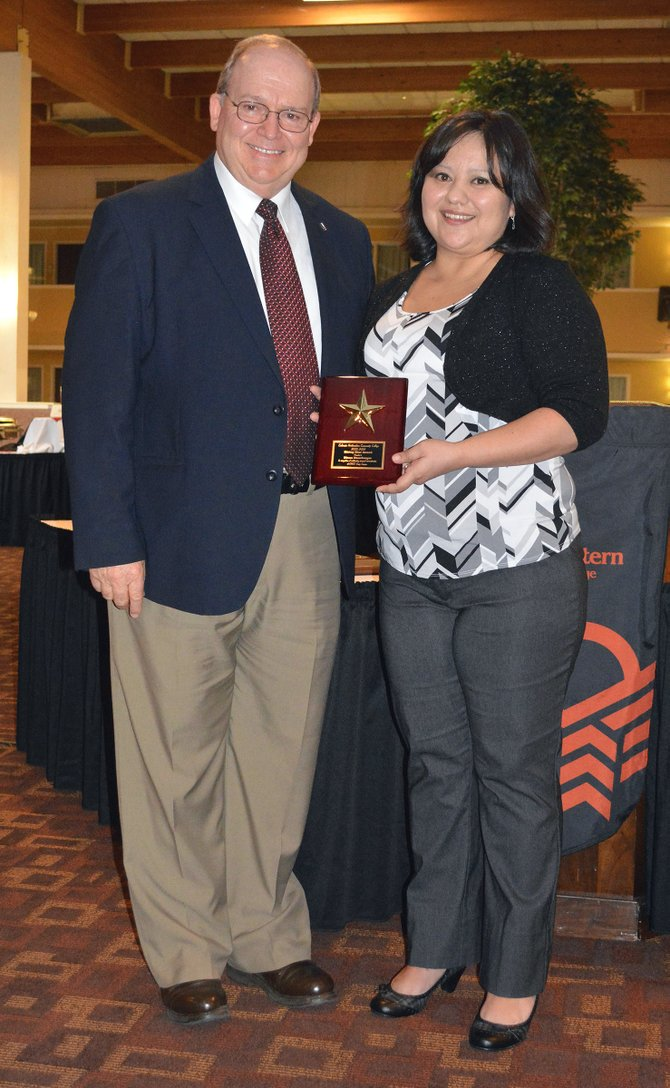 Colorado Northwestern Community College President Russell George, left, stands proudly with Rising Star Award recipient Diana Ransberger following the honors banquet for CNCC's Craig campus. The event acknowledged the best and brightest during the 2013-14 school year.