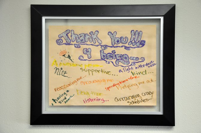 A thank you note from an adolescent abuse victim is framed inside her caseworker's office at the Routt County Department of Human Services. Local officials are hoping to raise awareness of how to prevent cases of child abuse and neglect.