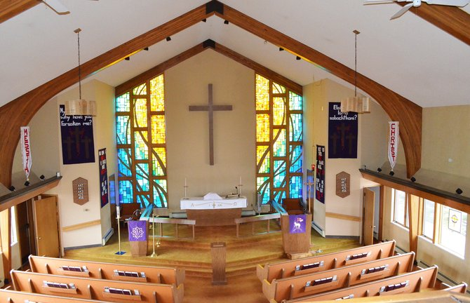 Faith Lutheran Church's bold and beautiful stained glass windows in the sanctuary offer an inviting place of faith and worship to local Christians.