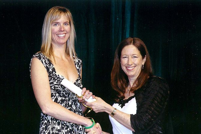Barbara Springer, the chairperson of the American Board of Physical Therapy Specialty Council, presents Jennifer Kerr with her certificate.