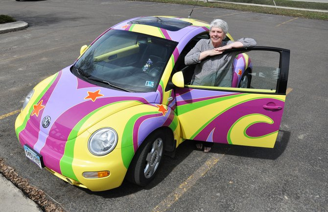 Jean Benton is celebrating 15 years of being cancer free this spring, and her colorful VW Bug just turned over 92,000 miles. She bought the car in 1999, the year she was diagnosed with breast cancer and underwent a mastectomy, and has been driving it ever since. Bennett says the car is the star and helps her share her story of survival with others.