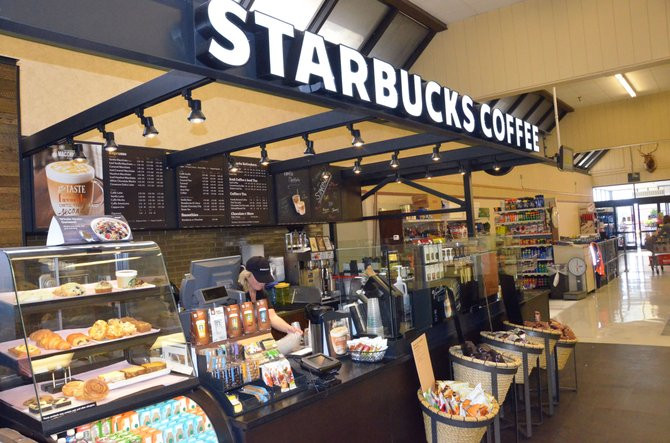 A kiosk for Starbucks Coffee Company is the newest feature within Craig's City Market. The location opened Sunday morning, following a six-month absence of Starbucks in the town, following the closure of Safeway.