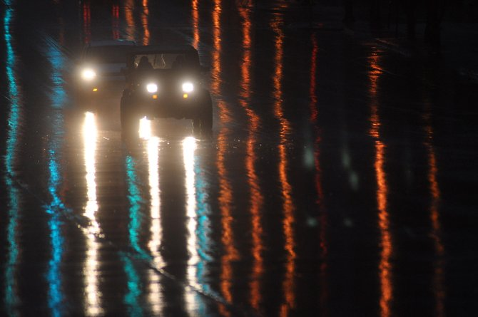 Headlights and streetlights are reflected on Lincoln Avenue on Wednesday morning. More rain showers are in the forecast this week.