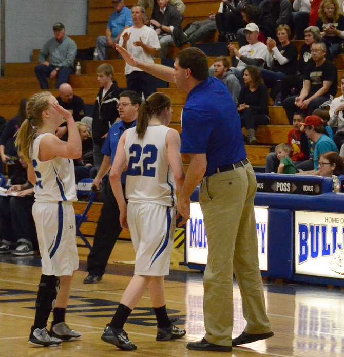 Matt Ray high-fives players after a regional tournament win in Craig during the 2012-13 season. Ray informed players and parents that he wouldn't be returning to coach the Bulldogs next season Thursday morning.
