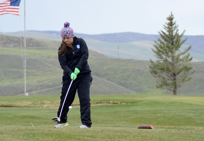 Lexie Gonzalez tees off the 10th green at Yampa Valley Golf Course on Monday. Gonzalez shot a 129 in cold and windy conditions while the Bulldogs took third place in the tournament.