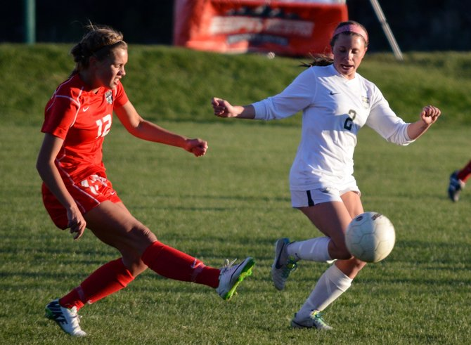 Steamboat Springs High School's Natalie Bohlmann, left, sends the ball up field past Battle Mountain's Molly Phannenstiel during the first half of Thursday's game at Gates Soccer Park in Glenwood Springs.