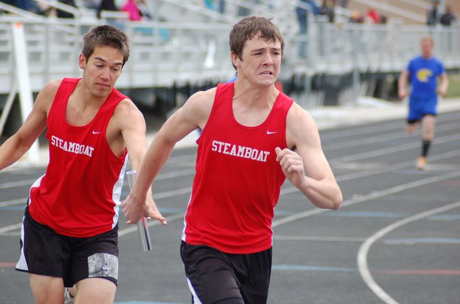 Steamboat's Zach Sperry hands the baton to Matthew Hansen during the boys 1,600-meter relay race Tuesday at a meet at Battle Mountain High School. The squad went on to finish seventh in the race.