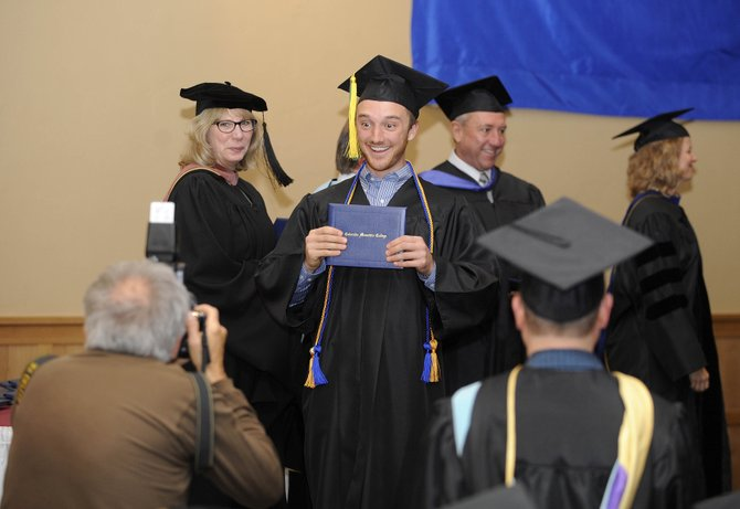 Ben Saheb is pictured with his bachelor's degree diploma during the Colorado Mountain College graduation ceremony Saturday at The Steamboat Grand.