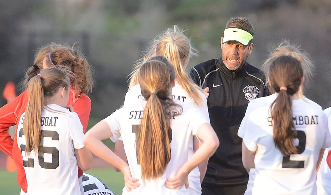 Coach Rob Bohlmann tries to pump up the Steamboat Springs High School girls soccer team Friday before the first overtime period. The Sailors were left out of the Class 4A playoff bracket this year for the first time since 2003.