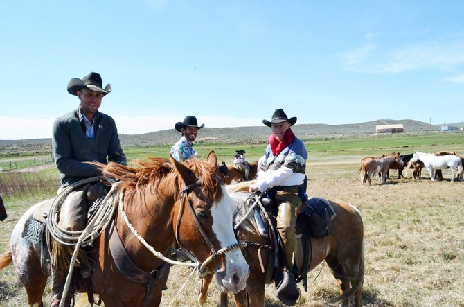 Zac Truer, left, Ken McCall and Sombrero Ranch Owner Rex Walker take a moment to rest Sunday, after driving more than 400 horses from the Sombrero Ranch in Browns Park through Maybell.