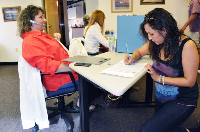 Lupita Valencia casts her ballot for the Craig Rural Fire Protection District election Tuesday.
