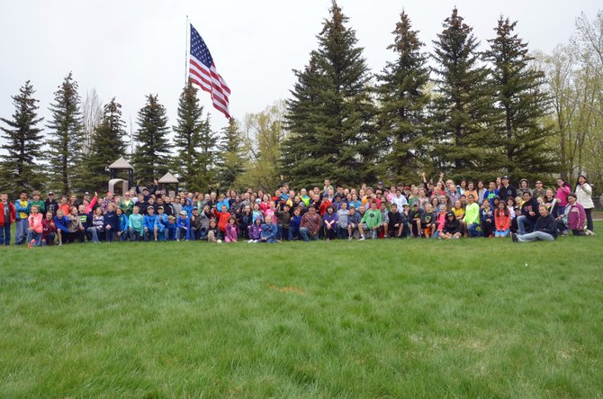 The students of East, Ridgeview, Sandrock and Sunset elementary schools gather during the end-of year event for  Passport to Reading on Friday at the Moffat County Fairgrounds picnic area. A total 196 fourth- and fifth-grade students from the four schools qualified to attend the event after reading at least 20 books during the school year.
