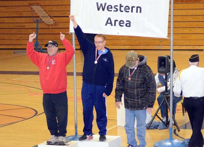 Jason Latham, center, and Ricky Rapalee celebrate their top-two finishes in the men's 400-meter walk Saturday at the Special Olympics Western Area Summer Games in Craig. A few hundred athletes and volunteers were at Moffat County High School for the annual event, which showcases track and field, swimming and powerlifting.