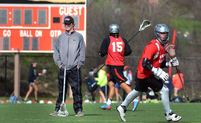 First-year Steamboat boys lacrosse coach Jay Lattimore runs his team through drills at practice Monday evening. The Sailors travel to Ponderosa on Wednesday with a shot at advancing to their first 4A state title game in program history.