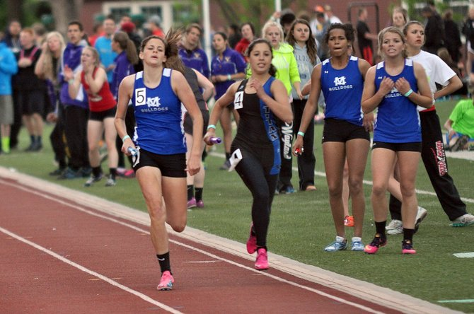 Makayla Johnson, left, tries to hold off her Coal Ridge opponent in the girls 1,600-meter relay last weekend in Grand Junction. The MCHS girls team had the ninth-best qualifying time in the state and will compete Friday at the state meet in Lakewood.