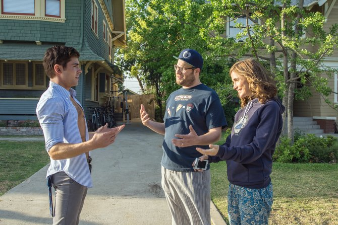 "Mac and Kelly (Seth Rogen, Rose Byrne) attempt to be friendly with fraternity president Teddy (Zac Efron) in ""Neighbors."" The movie is about a suburban couple whose lives are disrupted when a group of college students moves in next door."