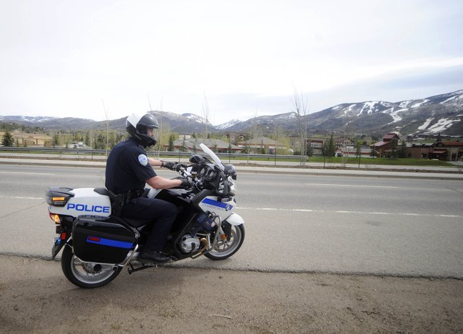 Steamboat Springs Police Department officer Ross Blank responds to a call Friday after doing traffic enforcement on South Lincoln Avenue.