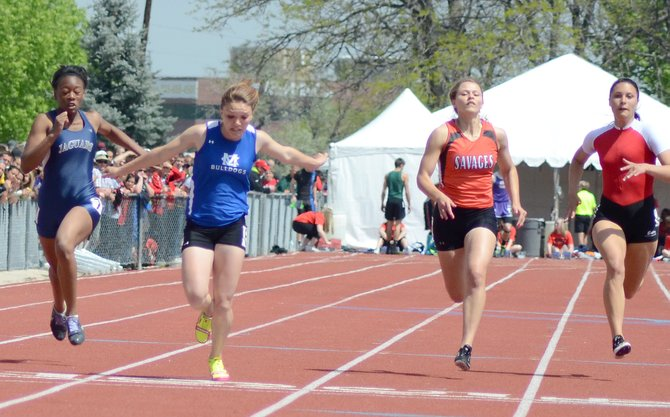 Kayla Pinnt leans into the finish line in the 100-meter dash finals Saturday at Jeffco Stadium in Lakewood. Her 12.04-second sprint was the fastest run in 3A this year and secured the Moffat County sophomore her first state championship. Pinnt later added to the tally, winning the 200, as well.