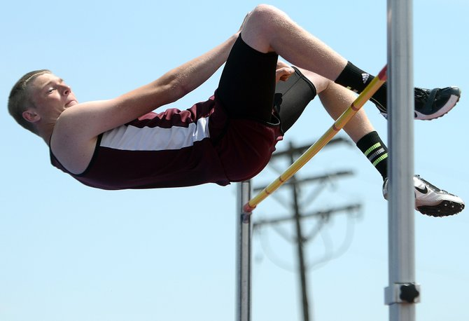 Soroco's Bjorn Carlson tries to clear 6-2 in the high jump Saturday at the state track meet. He cleared it with his body, but caught the bar with his foot. That still was good enough for a state medal, however, and he finished seventh.