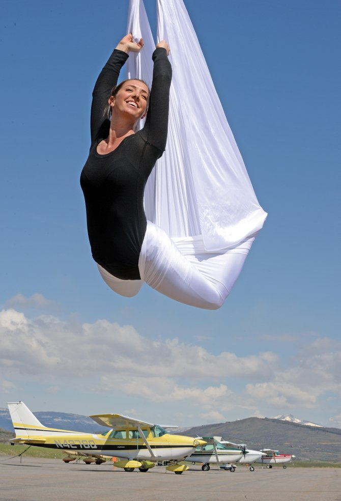 Aerial dancer Lora Labaree performs at the Steamboat Springs Airport.