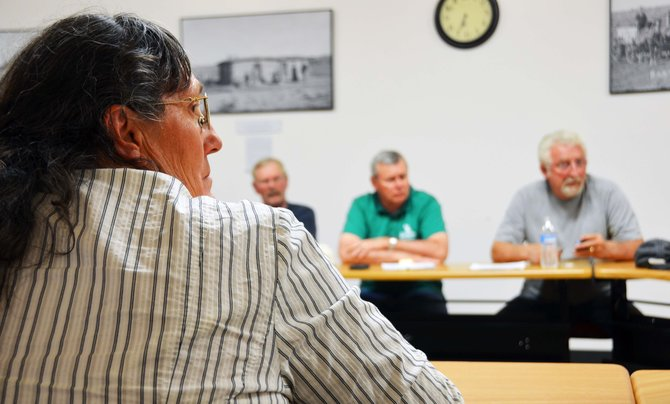Kris Brannan, Maybell resident, brings a petition before the Moffat County Commissioners, pressing them to repeal their ban on the sales and growth of retail marijuana in the county. Background, from left, Craig City Councilmember Don Jones, Moffat County Commissioners Chuck Grobe and Tom Mathers.