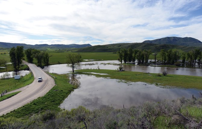 The Elk River has overrun its banks where it intersects with Rout County Road 42 just west of Steamboat Springs. The National Weather Service in Grand Junction is predicting that the Elk River at C.R. 42 will reach minor flood stage Wednesday night through Thursday morning, but it is not expected to threaten any homes at that level.