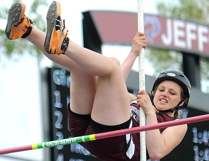 Soroco's Jessica Rossi flies over the bar May 16 during the state pole vault competition. The Rams junior finished tied for second in the event after she cleared 8 feet, 2 inches.