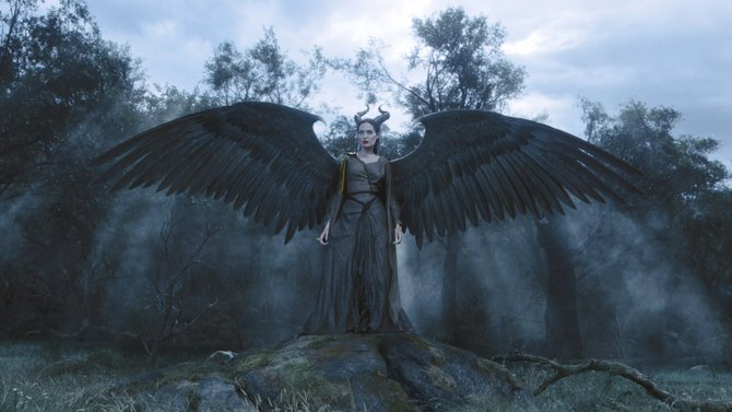 "The eponymous fairy (Angelina Jolie) stands guard at the edge of her magical realm in ""Maleficent."" The movie is a version of the fairy tale ""Sleeping Beauty"" taken from the point of view of its original villain."