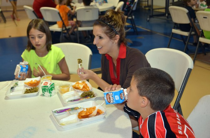 From left, Tayler Tipton, Kari Neuman and Sebastian Duarte enjoy a healthy lunch at the Boys & Girls Club of Craig. The organization provides meals to participating children during the summer, in addition to numerous other activities.