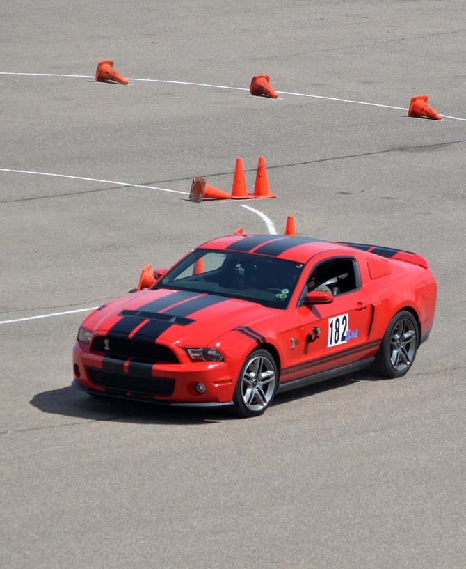Dale Cobrasky puts his Shelby Cobra GT500 through its paces during the Spring Autocross-Mustang Warmup at the Sill-TerHar Motors parking lot in Broomfield on May 4.