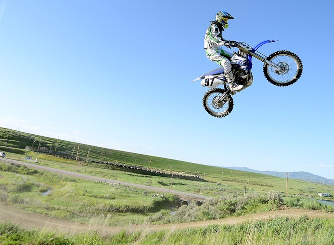 Mike Andrews flies high above the Stokes Gulch Motocross Track last week. Andrews and Eric Lodwick helped redesign the course this spring, and local motocross enthusiasts have been quick to take advantage. A season pass is available from the Hayden City Hall for $50.
