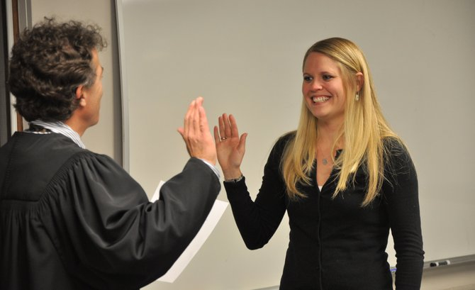 Steamboat Springs School Board President Rebecca Williams gets sworn in as a board member in 2011. Williams announced her plans to resign at the board's next meeting, citing family time commitment conflicts.