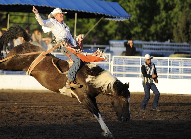 Kyle Weides, of Laramie, Wyoming, competes in the bareback riding competition during the Steamboat Springs Pro Rodeo Series season opener last year at the Brent Romick Rodeo Arena. The summer season begins at 7:30 p.m. Friday and Saturday, and will run throughout the summer through Aug. 16.