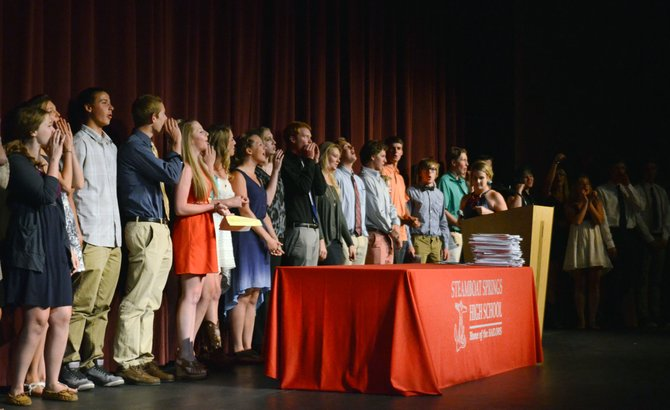 Steamboat Springs High School seniors shout out their class of 2014 chant at last Wednesday's scholarship night, where more than $817,000 in merit and local scholarships were awarded to the students' first year of college.