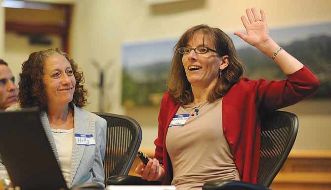 Krista Miller, human resources director for the town of Vail, speaks to a group Friday during the Welcome Home Steamboat housing forum at Citizen's Hall. Miller was addressing the audience as part of a panel discussing how to find housing solutions for locals.