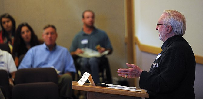 Jim DeFrancia, a principal and co-owner of Lowe Enterprises, speaks to a group Friday during the Welcome Home Steamboat housing forum at Citizen's Hall. DeFrancia was addressing the audience as the noon time speaker and has worked as a developer in other mountain communities.