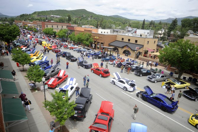 Mustangs line Lincoln Avenue during the Rocky Mountain Mustang Roundup Show 'n' Shine.