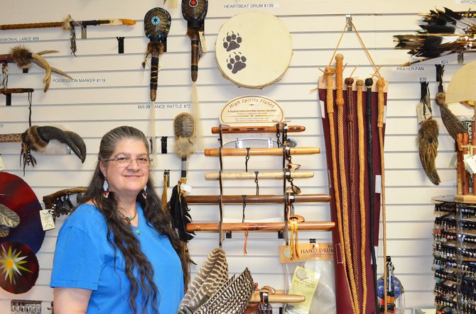 Chris Muzik, owner of Spirit Pass, stands in front of a selection of offerings sold at her store. Spirit Pass won first place for Best Place to Buy a Gift in this year's Best of Moffat County.
